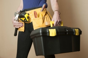 Female worker wearing a toolbelt work apron for tools