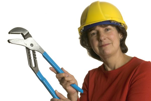 woman middle age with tools wearing safety helmet smiling home renovation